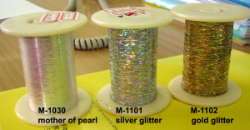 Metallic yarns with silver or gold glitter effect and mother of pearl effect