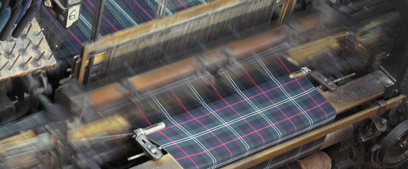 Weaving fabrics by various systems.